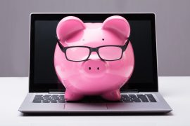 Piggybank On Laptop