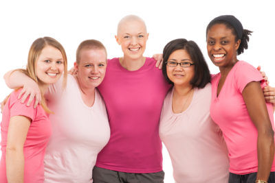 Survivors support each other with the pink badge of courage.