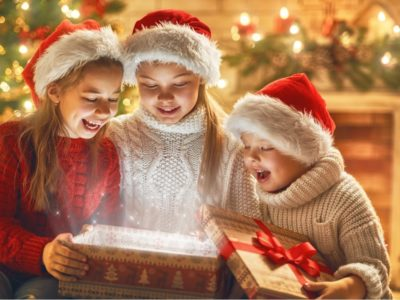 Children find reward under the Christmas tree, a glowing, magical box of love.